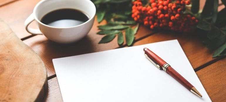blank paper with a pen and coffee cup