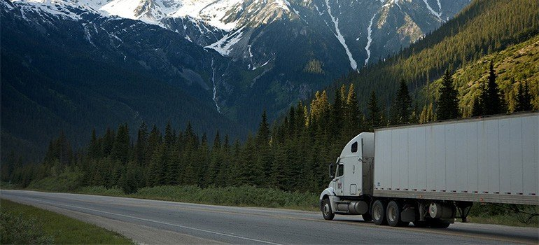 A large white truck on a highway
