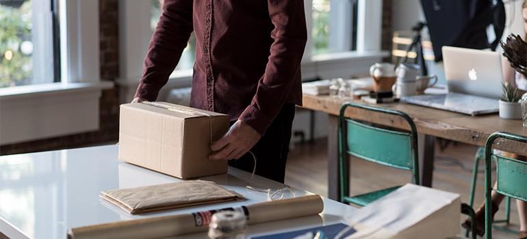 A man packing a box