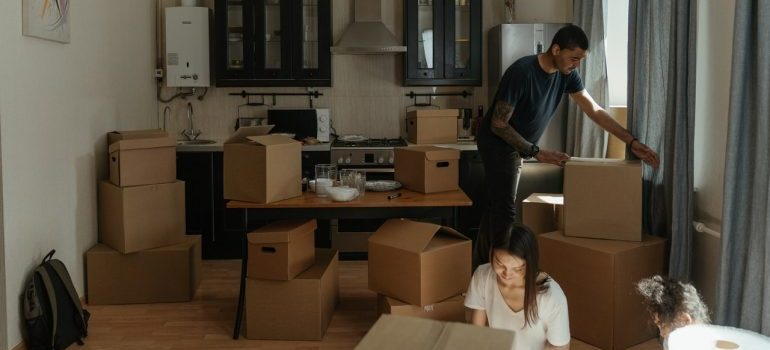 Man emptying boxes after learning how to make the unpacking process fun