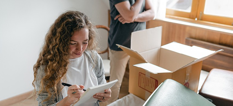 woman going over moving checklist