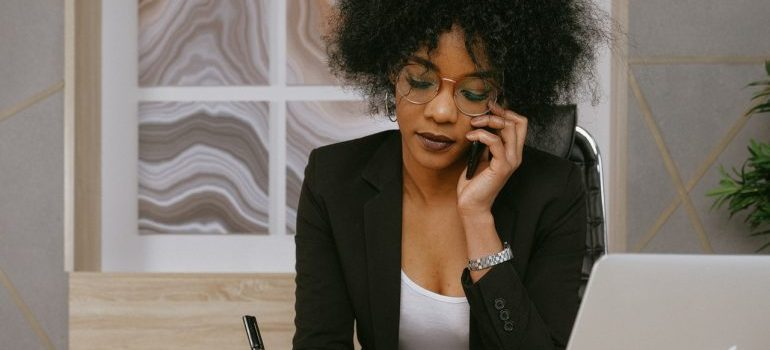 A woman calling to request moving services Philadelphia based movers can provide her with.