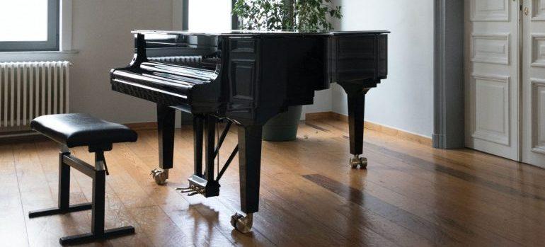 black piano in a bright room