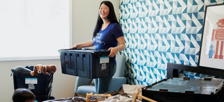 A woman packing for her move