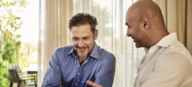 Two men talking about something