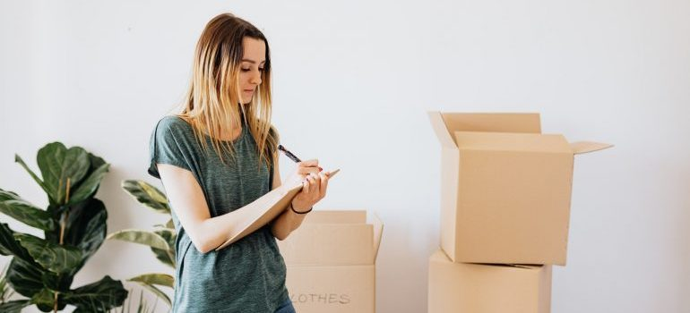 a woman deciding what not to pack when moving to Pennsylvania