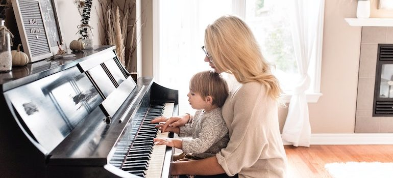mother and child playing a piano