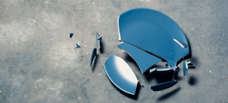 a broken plate on the floor