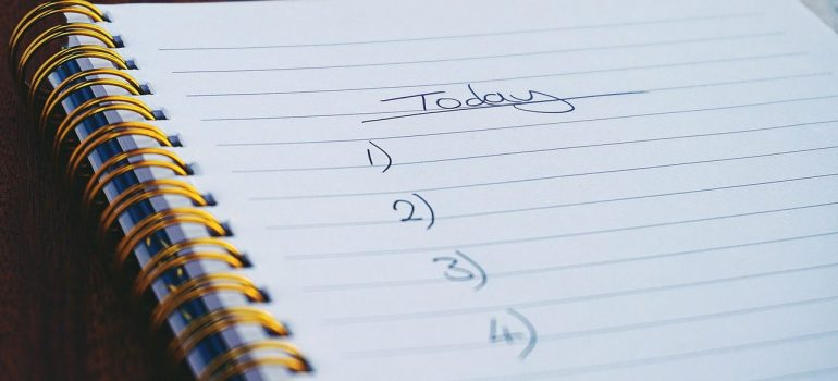 a notebook with plans on what to do today