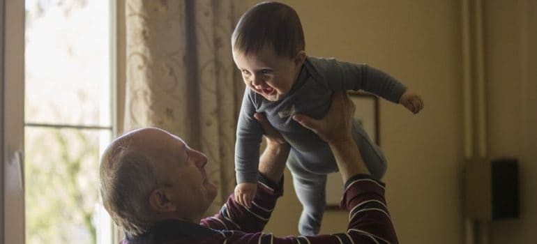 A grandparent playing with his grandson
