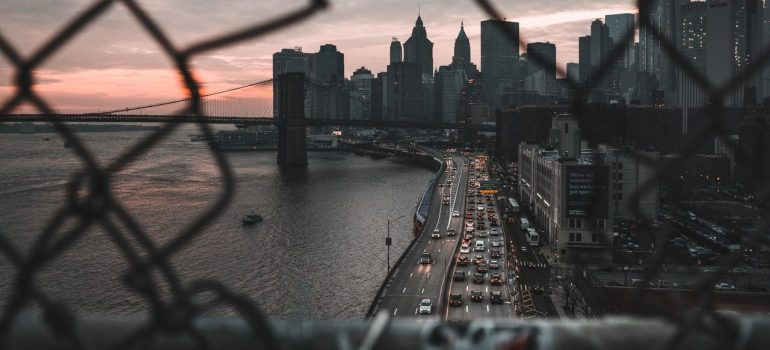 a picture of a part of new york through a ripped fence from one of many most instagrammable places in New York