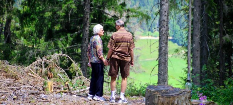 an elderly couple standing in nature in one of the best Delaware suburbs for seniors