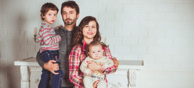a family of four posing for a photograph after moving to one of the places in Maryland for families